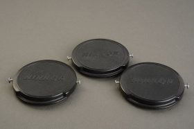 Nikon F 52mm front lens caps, early with metal buttons. Lot of 3