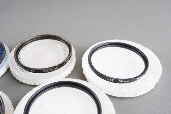 set of 10x genuine NIKON 52mm filters, most in cases, as per pictures