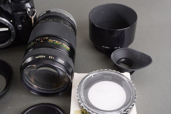 a small lot of untested lenses, accessories and Nikon F-301 camera – as found