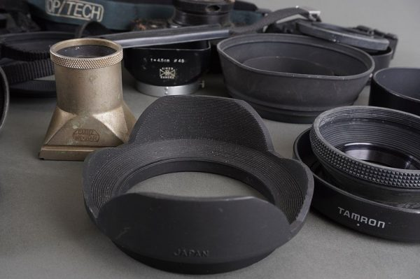 a big lot of various lens hoods + some accessories (straps, tubes, etc.)