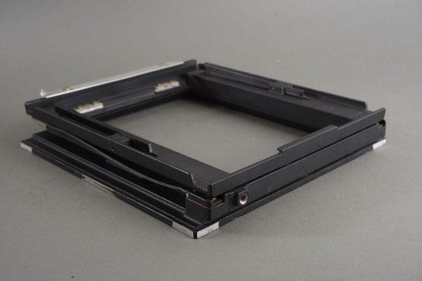 Part of 5×7 Sinar spring loaded film holder back, no screen