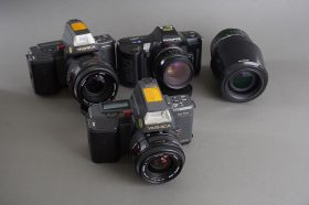 lot of 3x vintage AF cameras: Olympus + Yashica, with lenses
