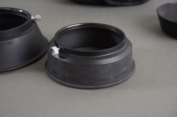 Olympus lens hoods: 1.8/50 (rubber), 3.5-4.5/35-105 (rubber), 3.5/28 (metal)