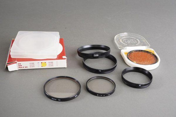 Leica Series VII UVa filter in 14161R retaining ring + B+W series 6 UV filter in 14160 retaining ring + extras