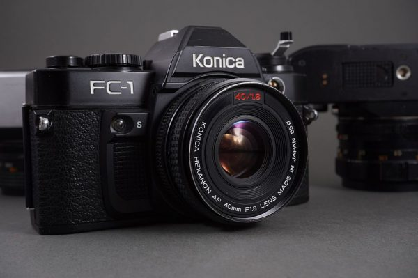 3x defective Konica SLR camera with lenses: 1.8/52, 1.8/50 and 1.8/40 Hexanons