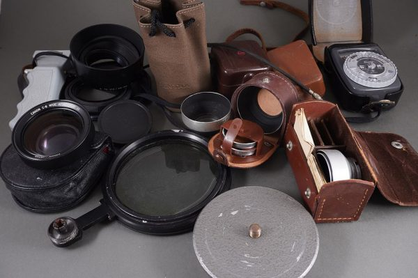 lot of various lens hoods, filters and other accessories, as per pictures