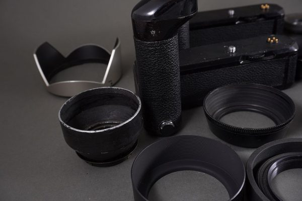 lot of 2x defective MD-12 Nikon motor drives + a bunch of lens hoods