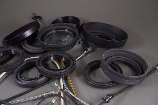 mixed lot of various lens hoods and cable releases, as per pictures