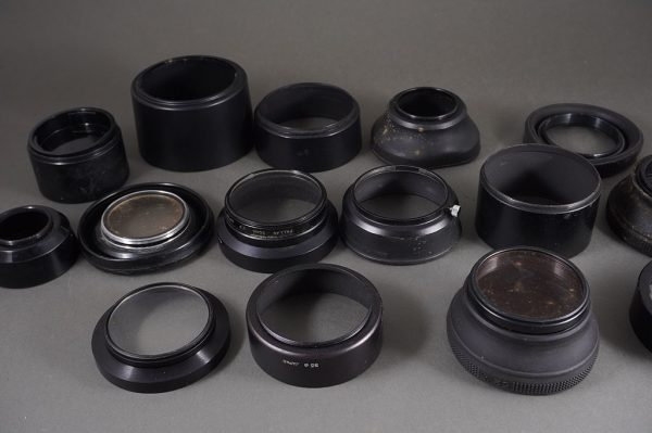 15x various lens hoods, including Canon and Olympus + some filters