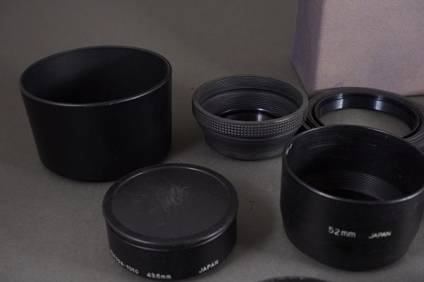 10x various lens hoods, including Minolta, Pentax and Olympus + Bronica Prism Finder box