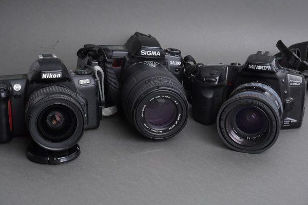 Lot of 3x SLR AF cameras with lenses: NNikon, Minolta, Sigma