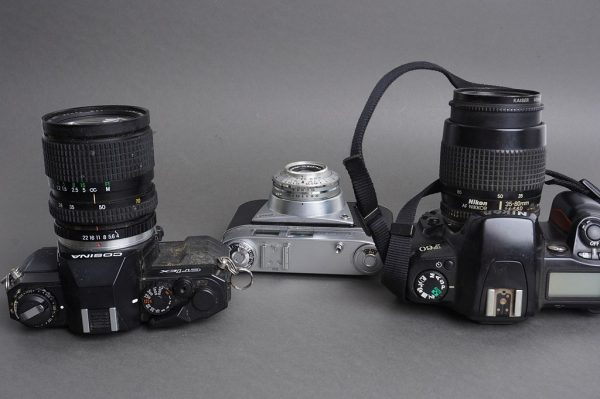 Nikon, Cosina, Kodak – lot of 3x vintage film cameras with lenses