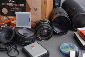 lot of 2x Sigma lenses in Canon EF mount + a bunch of various filters and other accessories