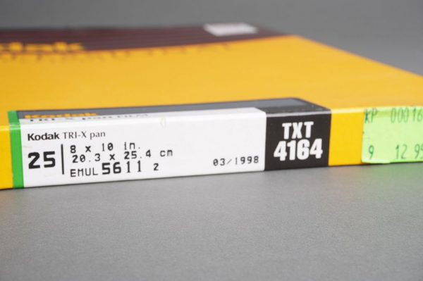 sealed box of 8×10 inches Kodak T-RIX pan / TXT 4164 film, 25 sheets, expired 03/1998