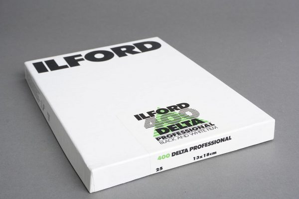 sealed box of Ilford Delta 400 13×18 cm film, 25 sheets, expired 04/2001