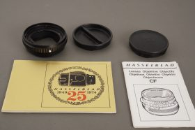 small lot of Hasselblad items: docs, caps, 21mm tube