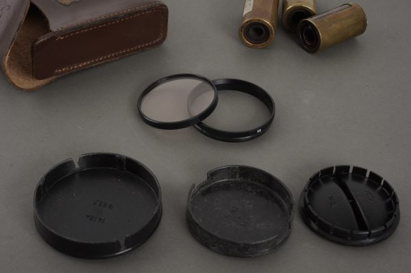 Small lot of Leica / Leitz accessories: caps, pouch, retaining ring, film cassettes