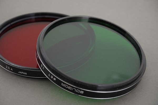 Soligor 67mm screw-in filters: 25A (red) and X2 (green)