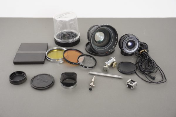 a bunch of various filters, caps, lenses and accessories – as per pictures