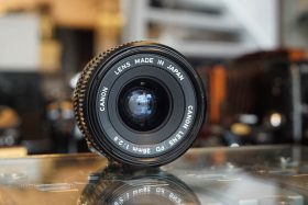 Canon lens FD 28mm 1:2.8, with box