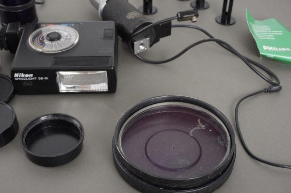 caps, flashes (Nikon, Leica), lens, motor drive + extras