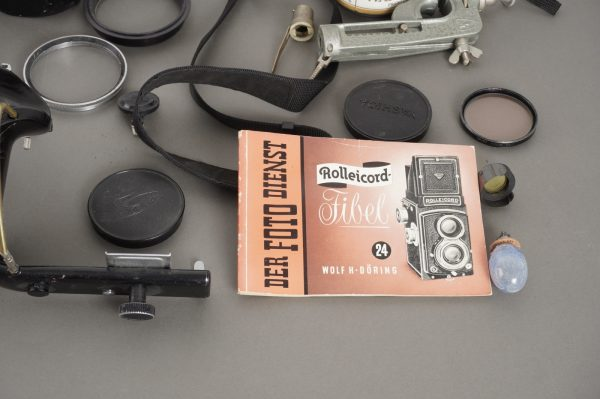 a bunch of various accessories, with some Hasselblad – mostly broken
