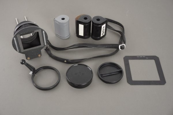 small lot of Hasselblad items: slide copier, caps, 70 film back reels, strap, mask