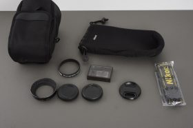 Small lot of Nikon accessories in CL-M3 lens case / pouch
