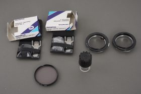 Small lot of Olympus items: reverse mounts, filter, diopters, case