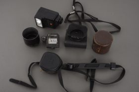 small lot of Pentax items: hoods, straps, pouches, meter, flash
