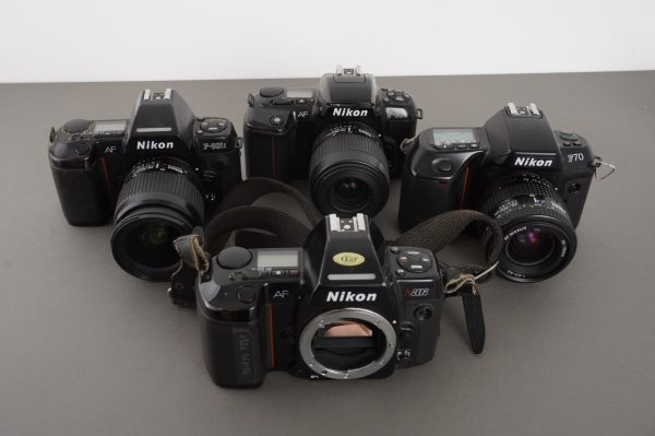 lot of 4x Nikon AF cameras with 3 zoom lenses, as found, not tested