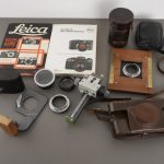 Lot of Leica related accessories and parts, cases, books, etc