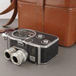 Bolex B8 camera with Berthiot lenses, cased, defect